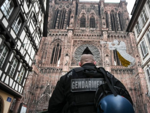 A French gendarme patrols in front of the Strasbourg cathedral while searches are conducted on December 12, 2018 for the gunman who opened fire near a Christmas market in Strasbourg, eastern France, the night before. - Hundreds of security forces were deployed in the hunt for a lone gunman who …
