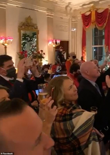 The video showed attendees standing closely together as they listened to the president speak